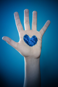 hand-with-blue-heart-for-autism